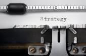 """Strategy"" written on an old typewriter — Stok fotoğraf"