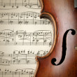Detail of old scratched violin on music sheet — Stock Photo #55707199
