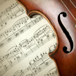 Detail of old scratched violin on music sheet — Stock Photo #55707283