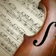 Detail of old scratched violin on music sheet — Stock Photo #55707379