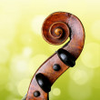 Violin peg box and scroll on green background — Stock Photo #55707599