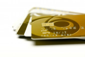 Gold credit cards isolated on white background — Zdjęcie stockowe