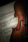 Detail of old scratched violin in shadow — Stock Photo