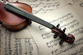 Detail of old scratched violin on music sheet — Stock Photo