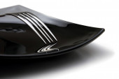 Detail of fork on the black plate — Stock Photo