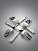The four interlocking silver forks — Foto Stock