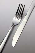 Fork and knife in opposition — Stock Photo