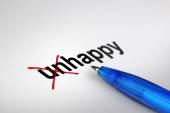 Changing the meaning of word. Unhappy into Happy. — Stock Photo