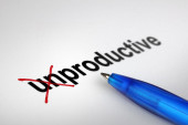 Changing the meaning of word. Unproductive into Productive. — Stock Photo
