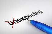 Changing the meaning of word. Unexpected into Expected. — Stock Photo
