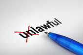 Changing the meaning of word. Unlawful into Lawful. — Stockfoto