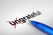 Changing the meaning of word. Ungrateful into Grateful. — Stock Photo