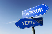 Tomorrow and Yesterday directions.  Opposite traffic sign. — Stock Photo