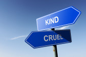 Kind and Cruel directions.  Opposite traffic sign. — Stock Photo