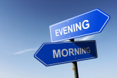 Evening and Morning directions.  Opposite traffic sign. — Stock Photo