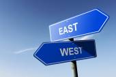 East and West directions.  Opposite traffic sign. — Stock Photo