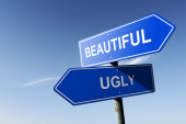 Beautiful and Ugly directions.  Opposite traffic sign. — Stock Photo