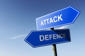 Attack and Defence directions.  Opposite traffic sign. — Стоковое фото
