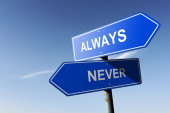 Always and Never directions.  Opposite traffic sign. — Stockfoto