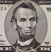 Abraham Lincoln portrait from five dollars bill — Stock Photo