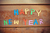 Happy New Year text  on wood background — Stock Photo