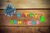 Happy New Year text  on wood background — Photo