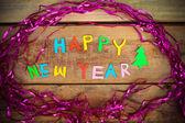 Feliz año nuevo texto sobre fondo de madera — Foto de Stock