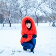 Outdoor portrait of young pretty beautiful woman in cold sunny winter weather in park. — Stock Photo #61414401