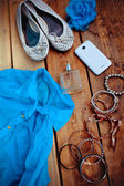 Fashionable female accessories, on t-shirt background — Stock Photo