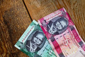 One and five Pound  Banknote from South Sudan on wood backgroun — Stock Photo