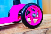 Outdoors background of playground with pink little kid scooter  — Stockfoto