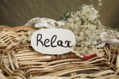 Tag with text relax on the white flowers — Stock Photo
