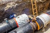 Welder is welding the pipeline in trench — Foto Stock