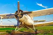 Biplane standing at sunset — Stock Photo