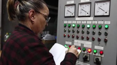 Woman engineer in control room — Stock Video