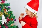 Happy small girl in Santa hat — Stock Photo
