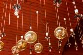 Chandelier hanging from ceiling — Stock Photo