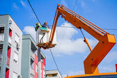 Power line team at work on a pole — Stock Photo