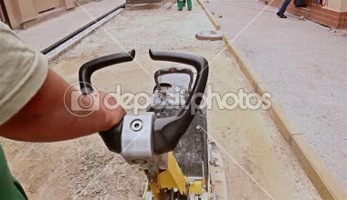Soil compacting is at construction site in the city street. — Stock Video