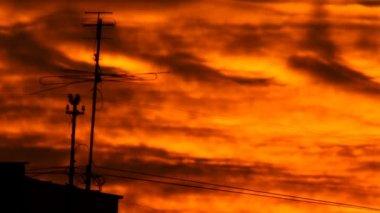 Antenna burning sunset — Stock Video
