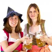 Women in dirndl clinking glasses — Stock Photo