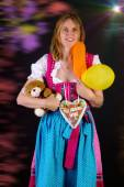 Woman in dirndl won some prizes at Oktoberfest — Stock Photo