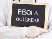 Doctor shows information: Ebola outbreak — Stock Photo