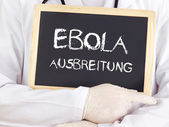 Doctor shows information: Ebola expansion in german — Stock Photo