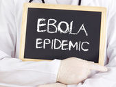Doctor shows information: Ebola epidemic — Stock Photo