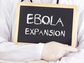 Doctor shows information: Ebola expansion — Stock Photo