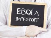 Doctor shows information: Ebola serum in german language — Stock Photo