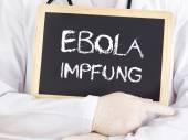 Doctor shows information: Ebola immunization in german — Stock Photo