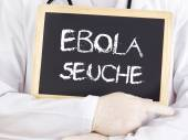 Doctor shows information: Ebola plague in german language — Stock Photo