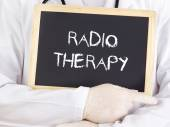 Doctor shows information: radiotherapy — Stock Photo